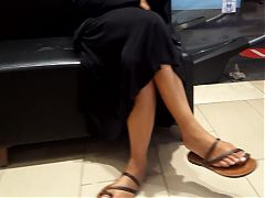 Her spicy teasing feet dangling, long feet and toes in sandals