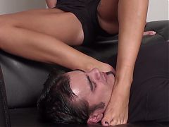 Dominant girls choking slaves with feet